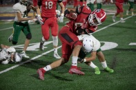 Argo running back clint Hutchinson (4) is tackled by Rancho's Alejandro Lopez (1) after gaining significant yardage.
