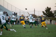 Anaheim's QB Fabian Gutierrez (15) goes deep early in the game against Rancho Alamitos.
