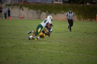 Colonist Omar Garcia (82) gets drilled on a screen pass by Rancho's Frank Nguyen