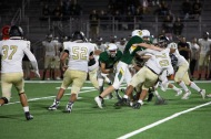 Rancho's Kyle Culbert (4) moves Magnolia's German Villa (70) out of the way so he can get in on the tackle.