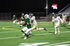 Rancho completes a pass to Manny Aguilar (27) late in the fourth quarter of Thursday's game against Magnolia High of Anaheim.
