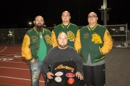 A band of Brothers named Alvarez, football players all. Back row (L-R) Frankie (2002), Jesus (2007), B.J. (2002) and seated Nestor (1995) regularly attend Rancho Alamitos football games. Nestor, Jesus and B.J. are brothers and Frankie, while no relation is considered to be a brother.