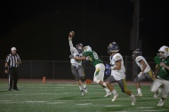 With pressure frum Vaquero Kevin Torres (88), Aztec QB Andrew Rumble barely gets the pass off.