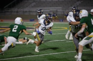 Aztec running back Long Phan (2) takes off through a hole in the offensive line during the 1st quarter of Friday's game against Rancho Alamitos.