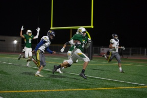Rancho's Jeremy Loqez (3) catches a pass at the 10 yard line and runs it in for 6 points.