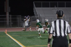 La Quinta's Long Phan beats double coverage and catchs a touchdown pass during the first quarter.