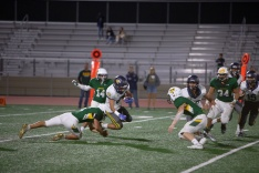Aztec Long Phan returns a 3rd quarter kickoff to about the 23 yard line, tripped up by Vaquero Jacob Renteria 95).