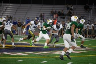 Vaquero Alejandro Lopez (1) runs up the middle early in the 4th quarter for good yardage.