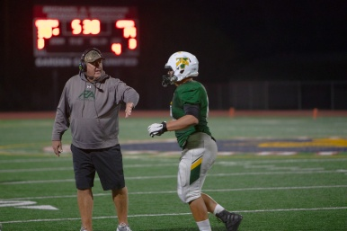 Rancho coach Mike Enright congratulates lineman Andrew Arechiga after a successful touchdown drive.