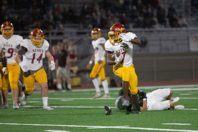 Aztec Walter Gooding (7) literally ran out of his own shoe to get away from Rancho's Jason Nguyen.