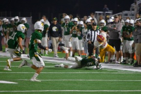 Rancho's Andrew Romero (6) nudges Aztec Isaac Contreras (8) out of bounds